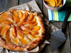 This peach tart is super easy to make with canned peaches! It's a perfect dessert to celebrate the end of summer!