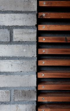 Brick meets wood on these walls. Visit houseandleisure.co.za for more