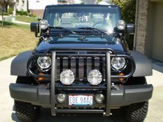Eight Senseless Jeep Modifications - 3. Lights mounted to the brush guard or grille