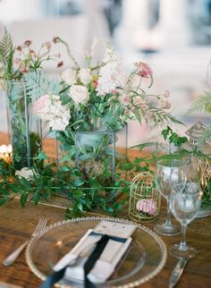 Centerpieces in Glass Containers. More on SMP: http://www.StyleMePretty.com/2014/05/28/romantic-glamour-in-miami/ Photography: KTMerry.com