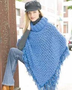 Easy poncho pattern with a cowl neck and fun fringe. Shown in Bernat Soft Boucle and Bernat Boa. Size 5.5mm (U.S. I or 9) and 6mm (U.S. J or 10) crochet hook.