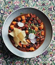 Slow-Cooker Vegetarian Chili With Sweet Potatoes   A game-day favorite fit for vegetarians. This chili is loaded with sweet potatoes, bell peppers, and a variety of beans.