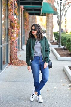 It's Bomb Dot Com - How to style a bomber jacket - My Style Vita. Grey graphic tee+skinny denim+white sneakers+green bomber+ black crossbody bag+jacket+aviator sunglasses. Fall Casual Outfit  2016