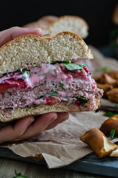 This strawberry goat cheese roast beef sandwich walks the line between gourmet and game food. Stuffed with roast beef and topped with a strawberry goat cheese spread, it's a bit of both in each bite.