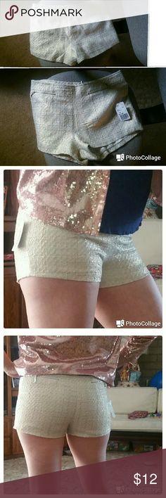 Forever 21 shorts New. Great shape flattering shorts. White and cream/goldish... Forever 21 Shorts