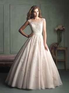 love this dress but I would put a liner in the top to make it modest