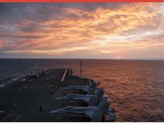 a beautiful sunset on the USS Theodore Roosevelt
