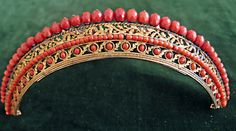 Hair comb. Pompon, coral. France, circa 1810.  If you love this check out Renaissance Fine Jewelry in Vermont.