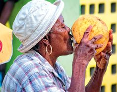 A local Dominica woman quaffs the essence of island life fresh from a coconut. #Dominica