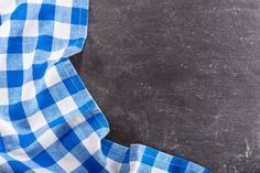 blue checkered tablecloth on dark table