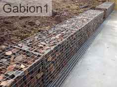 gabion retaining wall with drain at the front of the wall, http://www.gabion1.com.au
