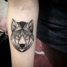 Forearm tattoo of a polygon wolf by Ivy Saruzi. Tattoo artist: Ivy Saruzi