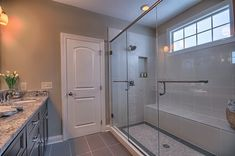 Our Bromley Ranch Plan - 7' Walkin Mstr Shower-  bench, cubbies, double doors, & double shower heads.