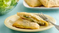 Rotisserie Chicken Pesto Crescent Pockets -- quick & easy meal using deli rotisserie chicken, but try using fresh jalapeno peppers, seeded & diced, in place of canned green chiles | Pillsbury