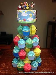 "Carole's celebration cakes and birthday cakes | Children A cupcake tower topped with a 6"" Mario inspired cake"