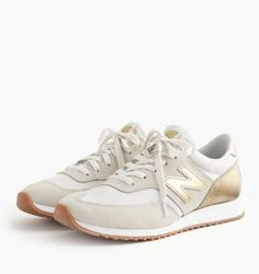Gold New Balance Sneakers, $80