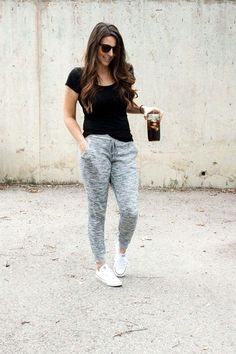 Cute but comfy sporty outfit - sneakers with grey tracksuit pants and a black tee with hair loose
