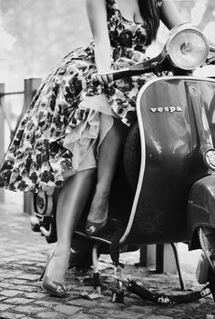 sexy chick in vespa scooter black n white