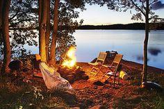 around a campfire, near water