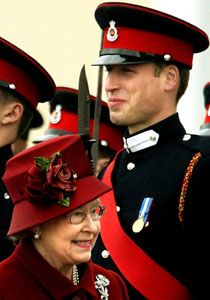 Queen Elizabeth passes her grandson Prince William, as she inspects graduates during a passing out parade at the Royal Military Academy Sandhurst, near Camberley, England.