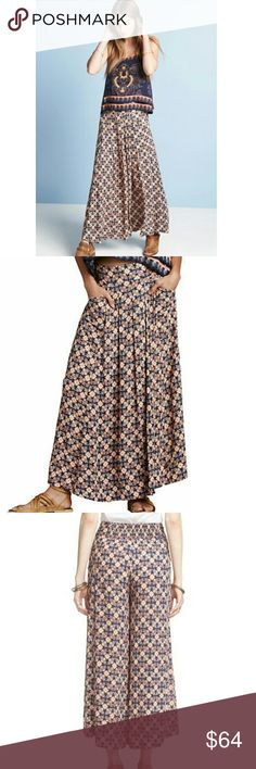 Free People Swept Away Culottes Blue Combo Sm NWT Free People Swept Away Blue Combo Colored Culottes Size Small NWT, A Bright Kaleidoscope Mosaic Print Adds Graphic Appeal To These Lightweight Culottes, Comfortable Smocked Waist, Pull On Style, Partially Lined, Side Slit Pockets, High Rise, Relaxed Fit Thru Hips & Thighs, 100% Rayon, Machine Washable, Looks Like A Skirt In Front & Culottes From Behind Free People Other