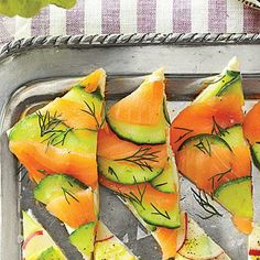 Salmon-Cucumber Tea Sandwiches | Make pretty mosaics with our all-purpose cream cheese spread and layering method. Salmon and cucumber make for a refreshing and delicious pairing. | SouthernLiving.com
