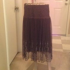 Brown Lacey skirt Brown lace with cream accents. Elastic waistband for comfort.  Brown lace accented waist piece, with solid brown underskirt.  Dress up for work or pair it with a jean jacket for a more casual look. Mei Na Skirts Midi