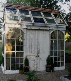 Greenhouse constructed from reclaimed doors, windows and millwork. by amy.shen