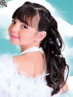 Long hairstyle with French braids to keep the hair controlled. The bangs are long and blunt cut.