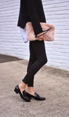 Black & white, loafers, pink furry clutch.