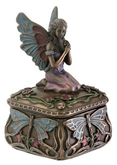 I know this isnt jewelry but it does hold it. :) Dragonfly Fairy Box Jewelry Holder Decoration Accessory Collectible Summit http://www.amazon.com/dp/B003V0URAY/ref=cm_sw_r_pi_dp_HxtSwb12615GT