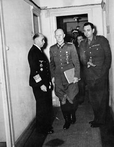 German surrender, May 1945: Generaloberst Alfred Jodl arrives at Rheims for the signing of the surrender document. On the left is Admiral Hans-Georg von Friedeburg, who co-signed the surrender instrument. He committed suicide on May 23, 1945. Jodl was convicted at Nuremberg and was hanged in October 1946.