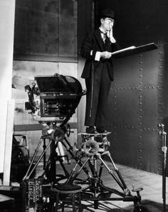 """hauntedbystorytelling: """" Buster Keaton on the MGM sound stage used for Speak Easily, 1932 (directed by Edward Sedgwick) / src: IMDb more [+] Buster Keaton posts """" Buster Keaton, Physical Comedy, Sound Stage, Singing In The Rain, Broken Leg, Silent Film, Classic Films, Old Hollywood, Fotografia"""