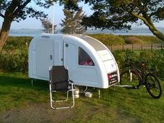This micro camper sleeps two adults and can be towed by bicycle