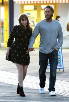 Travis Fimmel Photos Photos - Lena Dunham and Travis Fimmel hold hands as they shoot a romantic scene for an untitled short film project in Brooklyn, New York's Coney Island Boardwalk on April 14, 2017. - Lena Dunham and Travis Fimmel Film at the Coney Island Boardwalk