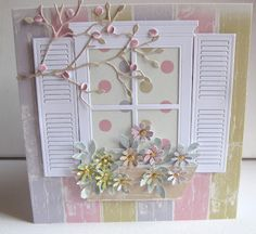 The flowers were punched from the pastel papers, and shaped with a foam mat and a ball tool before being arranged into the window box, which I cut by hand.  I put some blossoms onto the twig branch, to make it more Springlike. Do you know what they are? I punched holes using the largest punch on a cropadile, and collected the little punched circles. They are perfect!