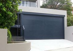 Black roller garage door. Modern Garage Door and Gates https://www.pinterest.com/avivbeber3/modern-garage-door-and-gates/ #Modern Garage door #clopay #Avante