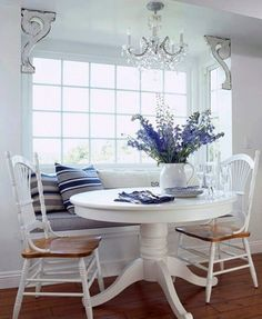 Breakfast nook with window seat . Like how they installed a chandelier up above the window seat. Kitchen Benches, Kitchen Nook, Kitchen Banquette, Kitchen Seating, Kitchen Tables, Kitchen Ideas, Kitchen Dining, Round Kitchen, Farm Tables