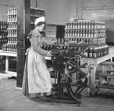 c. 1897, Female worker in Heinz factory, bottling ketchup.