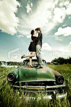 standing on car kissing