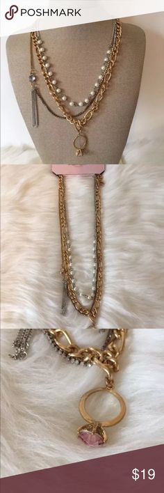 """Juicy Couture Necklace Layered Gold Tone Brand New Juicy Couture Necklace Layered Gold Tone Faux Pearl New Retails $34 Jewelry NWT Item Description: • Brand New • 3 Layer necklace: gold tone, silver tone, faux pearl • Gold tone pendant ring with pink faux diamond • Blue faux stone with silver chain tassels •'Longest Chain drop on thick gold tone chain with ring pendant charm: 11"""" approximate • Adjustable chain •Retail price: $34.00 Juicy Couture Jewelry Necklaces"""
