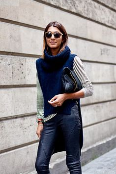 Thick sweater with cowl neck. Nice sheen to the skinny pant. The sunglasses are chic and the striped shirt gives the whole look some pizazz.