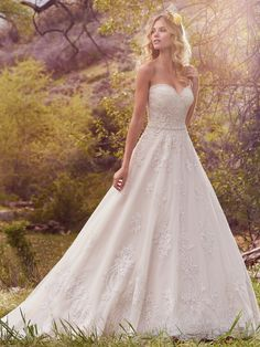 Beaded full skirt A-line wedding dress with sweetheart neckline. | Maggie Sottero | Style: Reba