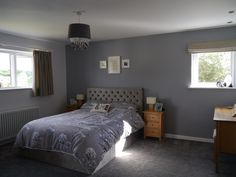 Walls in Dulux warm pewter & white mist. Bed - Paris with lift up storage in French grey from next. Bedding also Next. Blinds & curtains from Dunelm at home on Malibu Feather.