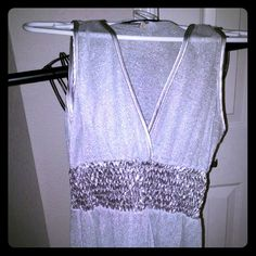 Silver metallic tank So cute silver see thru top! Very cute cinched middle, very sparkly. Size m, brand is rox. Fits on small side of medium. Tops Tank Tops