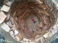 Gravity, Stone and Water. A spiral staircase cistern design holds 10,000 gallons designed & built by Thea the owner. Permaculture