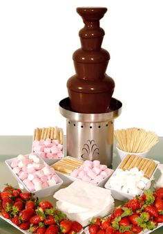 Chocolate fountains are extremely popular at weddings nowadays, but in my experience, you need to be careful. Having one can be great and who doesn't love chocolate? But if you set it up in the same r (Fountain Chocolate Ideas) Chocolate Fountain Rental, Chocolate Fountain Recipes, Chocolate Fountains, Chocolate Fountain Wedding, Chocolate Fondue Bar, Hotel Chocolate, Candy Table, Candy Buffet, Dessert Table