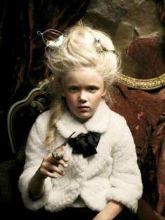 elegant/creepy.creepy little rich girl. love the old school vibe.