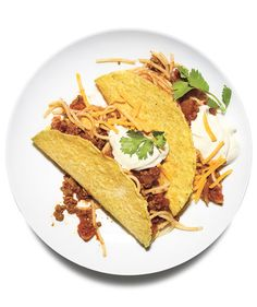 Try a twist on a classic by adding spaghetti to your beef tacos for a fun and easy recipes your kids are sure to love! @realsimple
