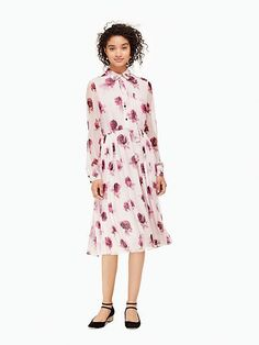 featuring a dramatic floral design that's inspired by the roses tossed on stage at the end of a show, this silk dress is pretty enough for date nights but covered enough for any day job--it's sure to